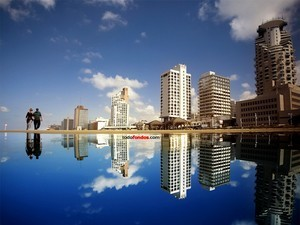 Buildings reflected in the water