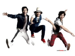 The Jonas Brothers jumping