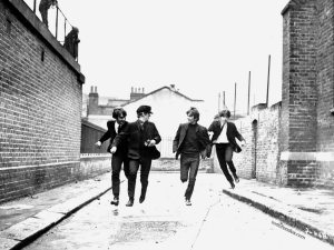 The Beatles running by the streets of Liverpool