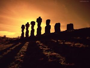 Moai stone statues at sunset (Easter Island)