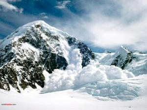 Snow avalanche in the mountain