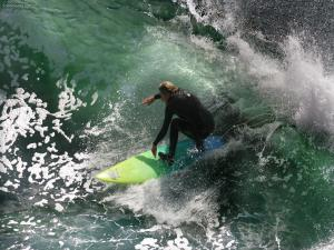 Surfing in green waters