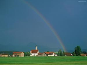 Rainbow over a blue sky