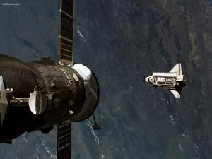 Satellite over the space shuttle