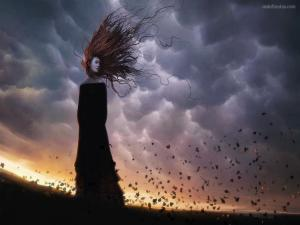 Girl dressed in black with long hair on a windy day