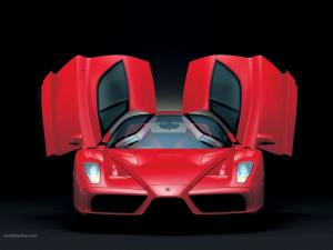 A red Ferrari with open doors