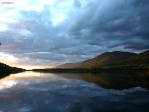 Clouds darkening the lake
