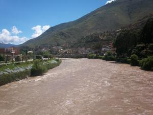 River crossing the city of Huanuco in Peru