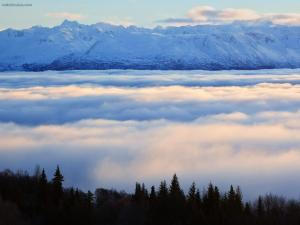 Snowy mountains above the clouds