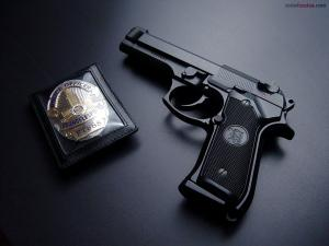 Badge and gun of Los Angeles Police