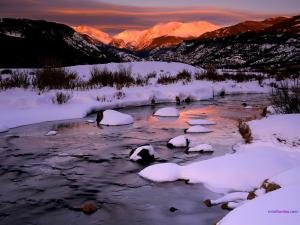 Snow on the shore of the river