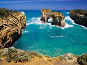 Natural stone door in blue waters
