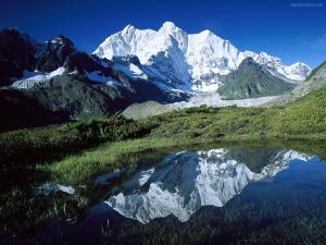 Pond reflecting a snowy mountain