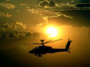 Helicopter with the sun of background
