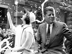 John and Jackie Kennedy in a parade