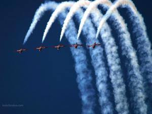 Acrobatic aircrafts drawing the sky