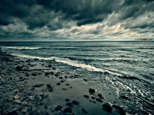 Dark clouds on the beach