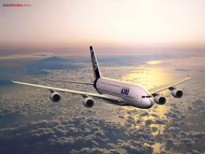 Airbus A380 flying over clouds