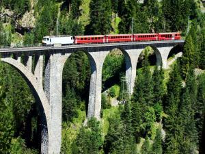 Train over a very high bridge in Wiesen, Switzerland