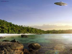 UFO flying over the beach