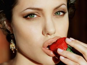 Angelina Jolie biting a strawberry