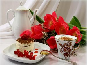 Romantic breakfast with coffee, cake and flowers