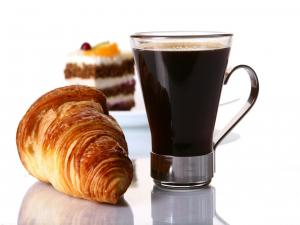 Black coffee, with croissant and cake