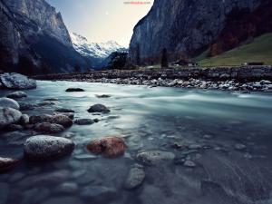 River between mountains, in Lauterbrunnen (Switzerland)