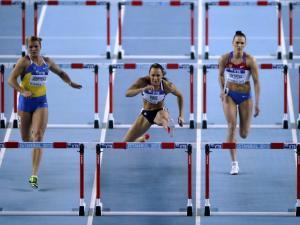 Athletes in hurdling