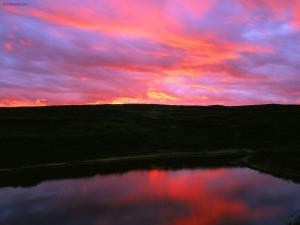 Reddish sky over a lake