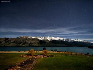 Lake Wakatipu under a starry night (New Zealand)
