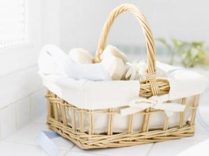 Basket with towel, toothbrush and soaps