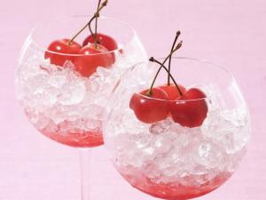 Two cups with ice and three cherries