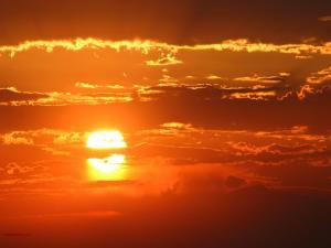 Burning sun, in a sky of clouds
