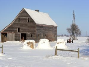 Wooden barn in a snowy landscape