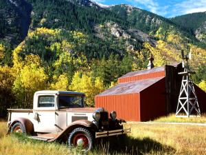 Vintage car beside a barn