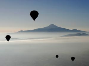 Hot air ballooning with the mountain in background