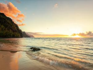 A beach in the island of Kauai (Hawaii) at sunset