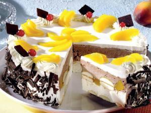Tart with cream, peach, cherry and chocolate