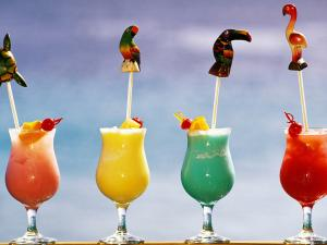 Colored cocktails with tropical decorations