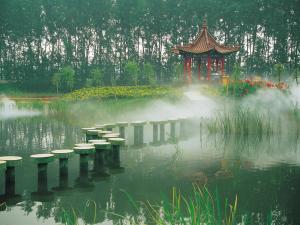 Original walkway to cross a small lake of an oriental garden