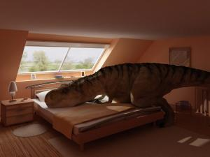 A dinosaur over the bed