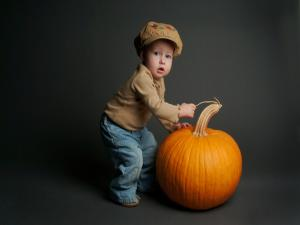 Child with a pumpkin