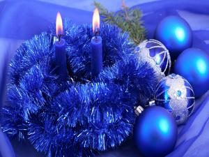 Candles and Christmas decorations in blue colors