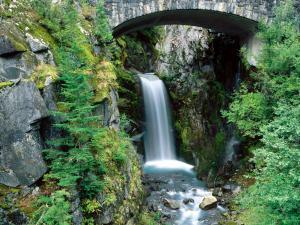 Waterfall under a stone bridge