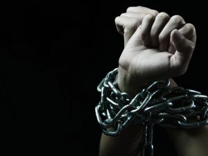 Hands tied with chains