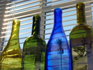 Colorful bottles with landscapes within