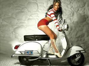 Jennifer Lopez mounted on a Vespa
