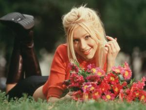 Christina Aguilera in a park with flowers