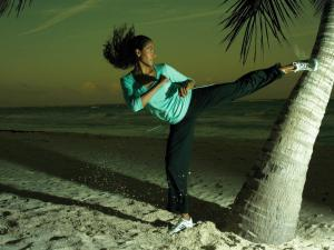 Nightly training of martial arts on the beach